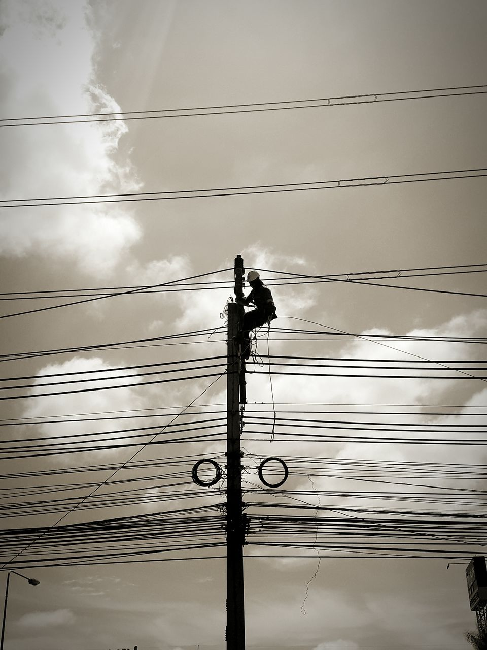 cable, electricity, power line, power supply, fuel and power generation, connection, technology, low angle view, sky, cloud - sky, electricity pylon, nature, no people, complexity, outdoors, silhouette, power, day, lighting equipment, power cable, light, electrical equipment, telephone line