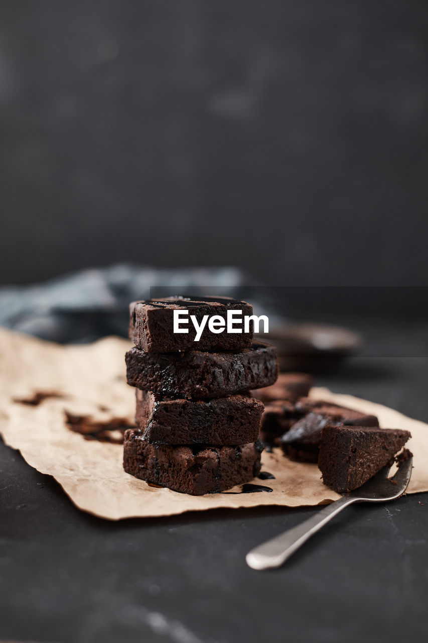 sweet food, chocolate, food and drink, food, freshness, temptation, still life, sweet, indulgence, dessert, indoors, ready-to-eat, table, close-up, no people, brown, selective focus, unhealthy eating, brownie, baked, chocolate cake, black background