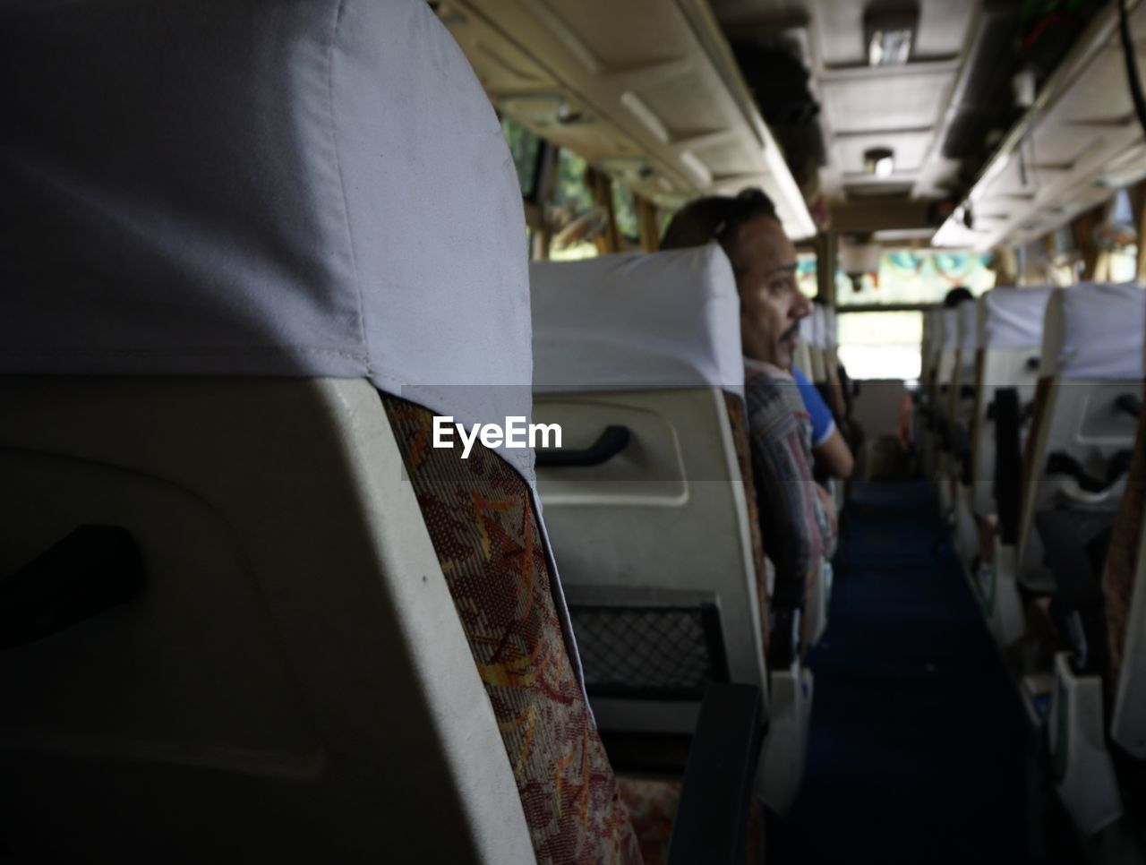 vehicle interior, transportation, mode of transport, public transportation, vehicle seat, land vehicle, real people, men, bus, indoors, day, one person, adult, people