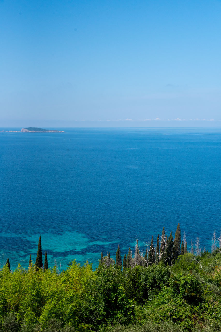 sea, horizon over water, water, tranquil scene, nature, beauty in nature, blue, tranquility, scenics, no people, day, outdoors, sky, plant, clear sky, beach, tree