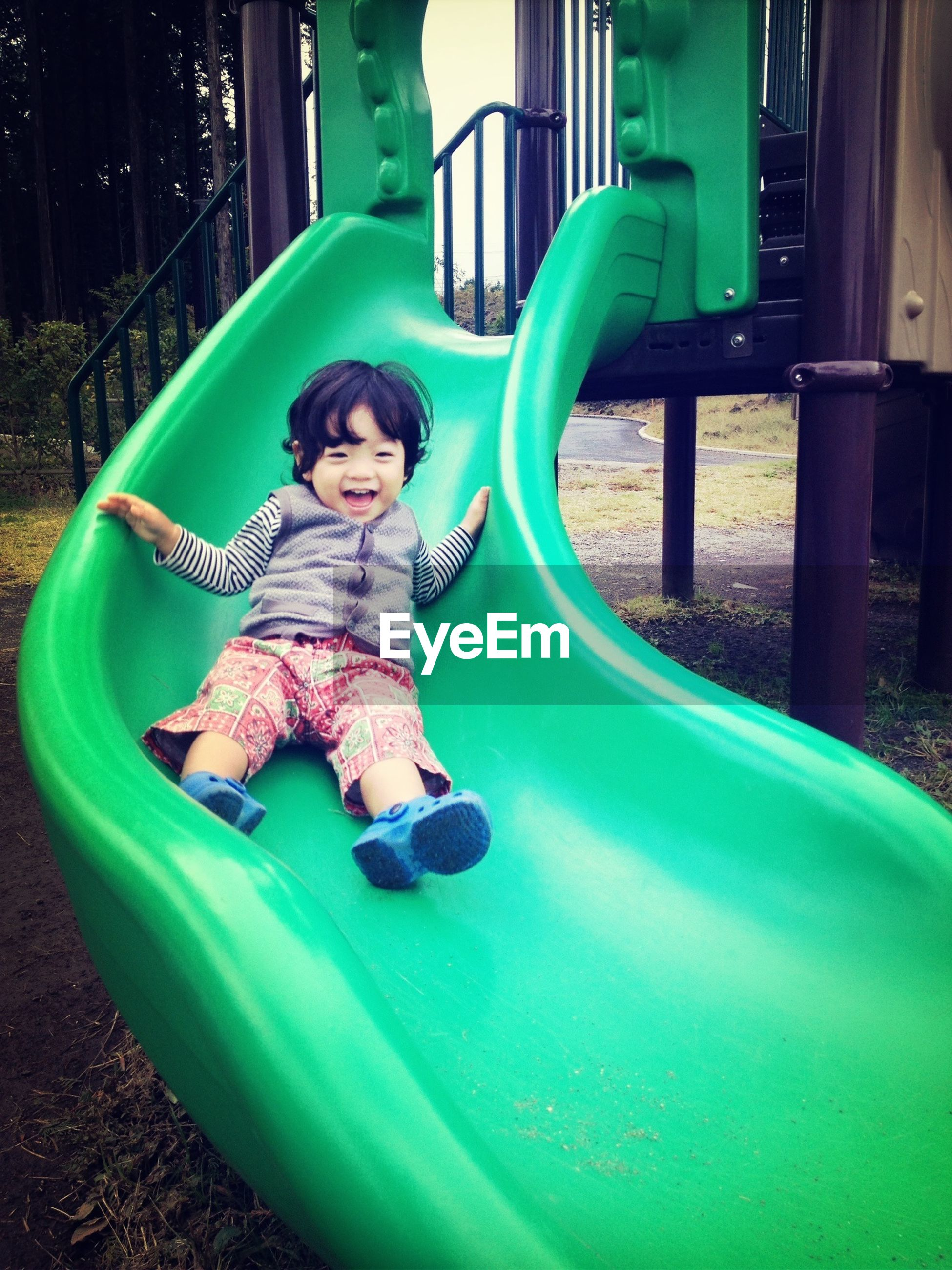 childhood, person, elementary age, full length, lifestyles, leisure activity, innocence, casual clothing, boys, girls, cute, sitting, playing, looking at camera, playful, portrait, fun, happiness