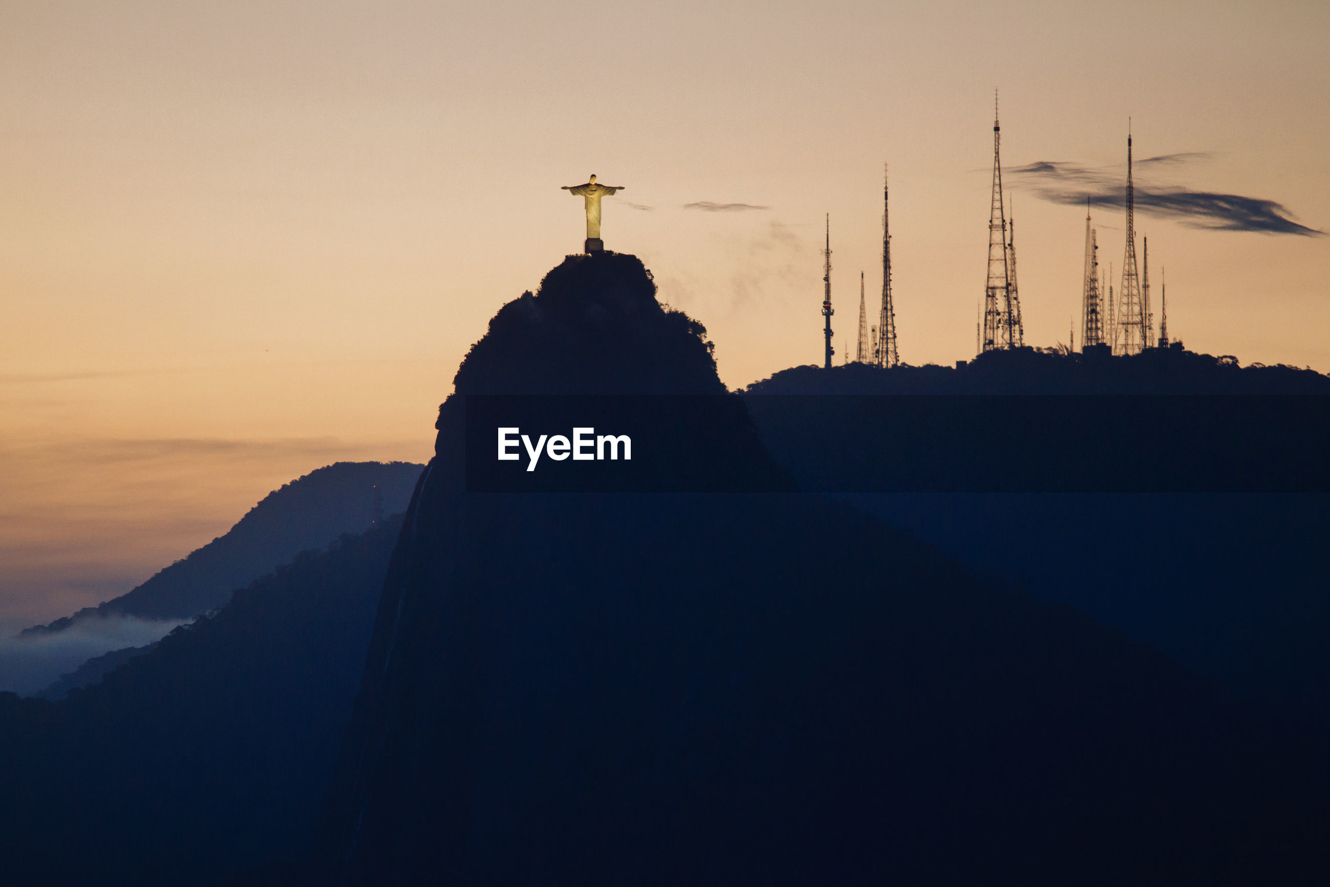 Christ the redeemer statue on mountain during sunset