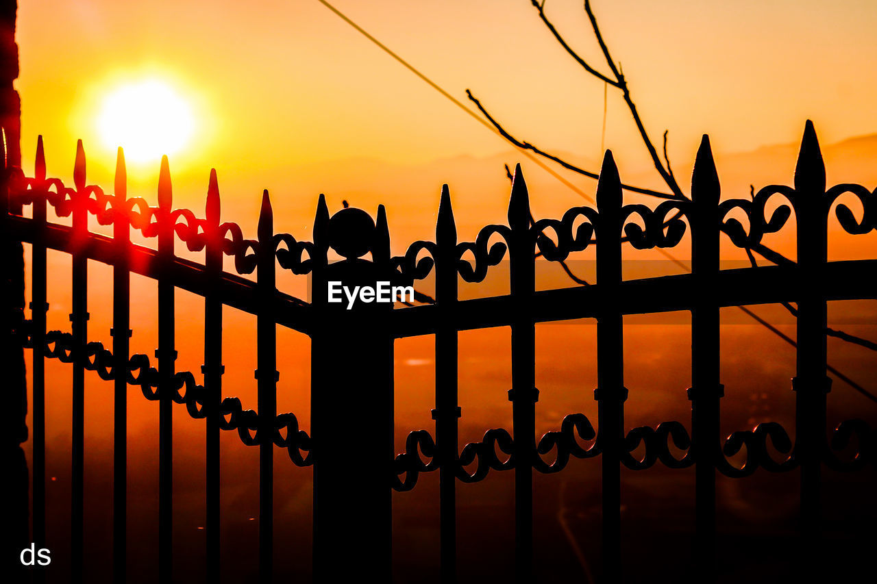 sunset, silhouette, railing, orange color, sun, sea, outdoors, sky, water, bird, men, nature, real people, day