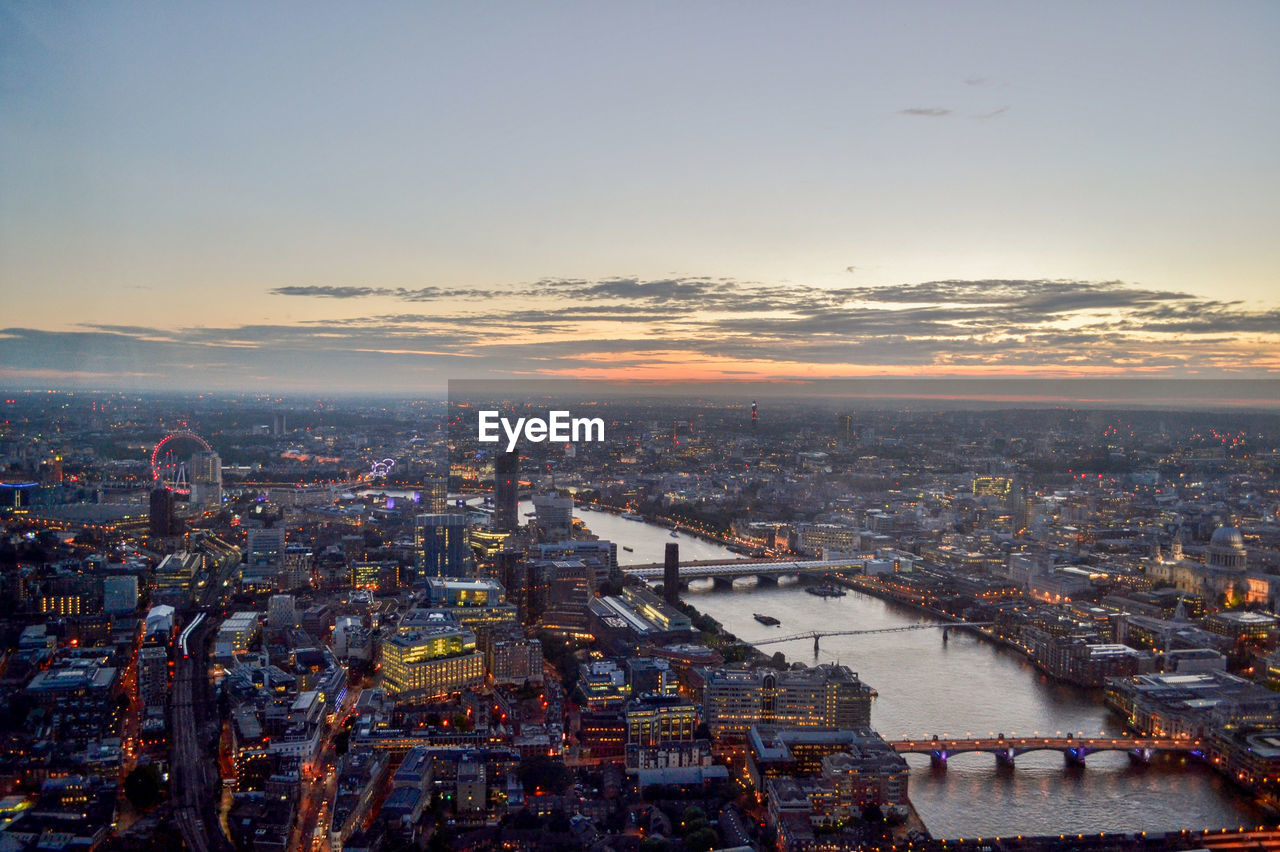 Aerial View Of River And City During Sunset