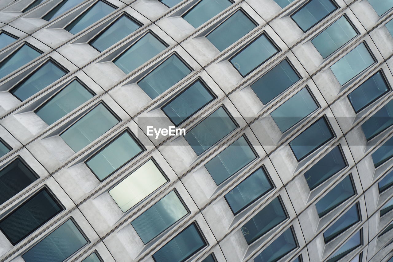 architecture, built structure, building exterior, low angle view, building, glass - material, full frame, office, window, no people, office building exterior, backgrounds, pattern, day, modern, city, shape, outdoors, geometric shape, glass