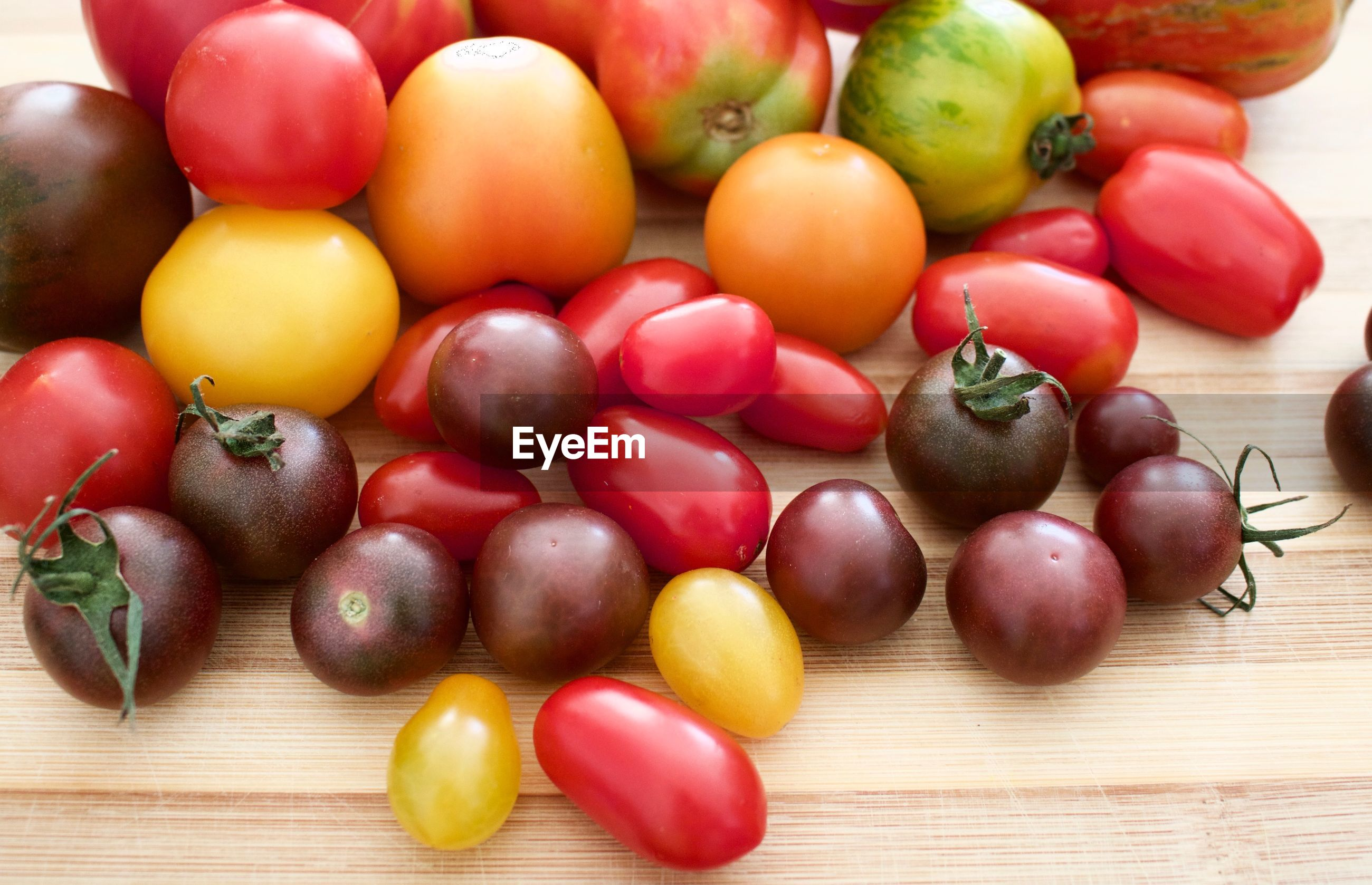 High angle view of various tomatoes on table