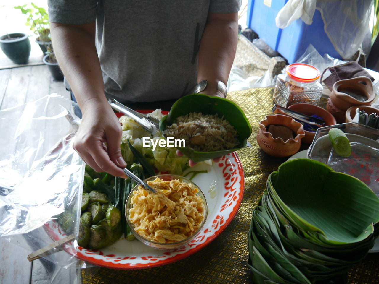 Midsection Of Man Picking Food From Bowl