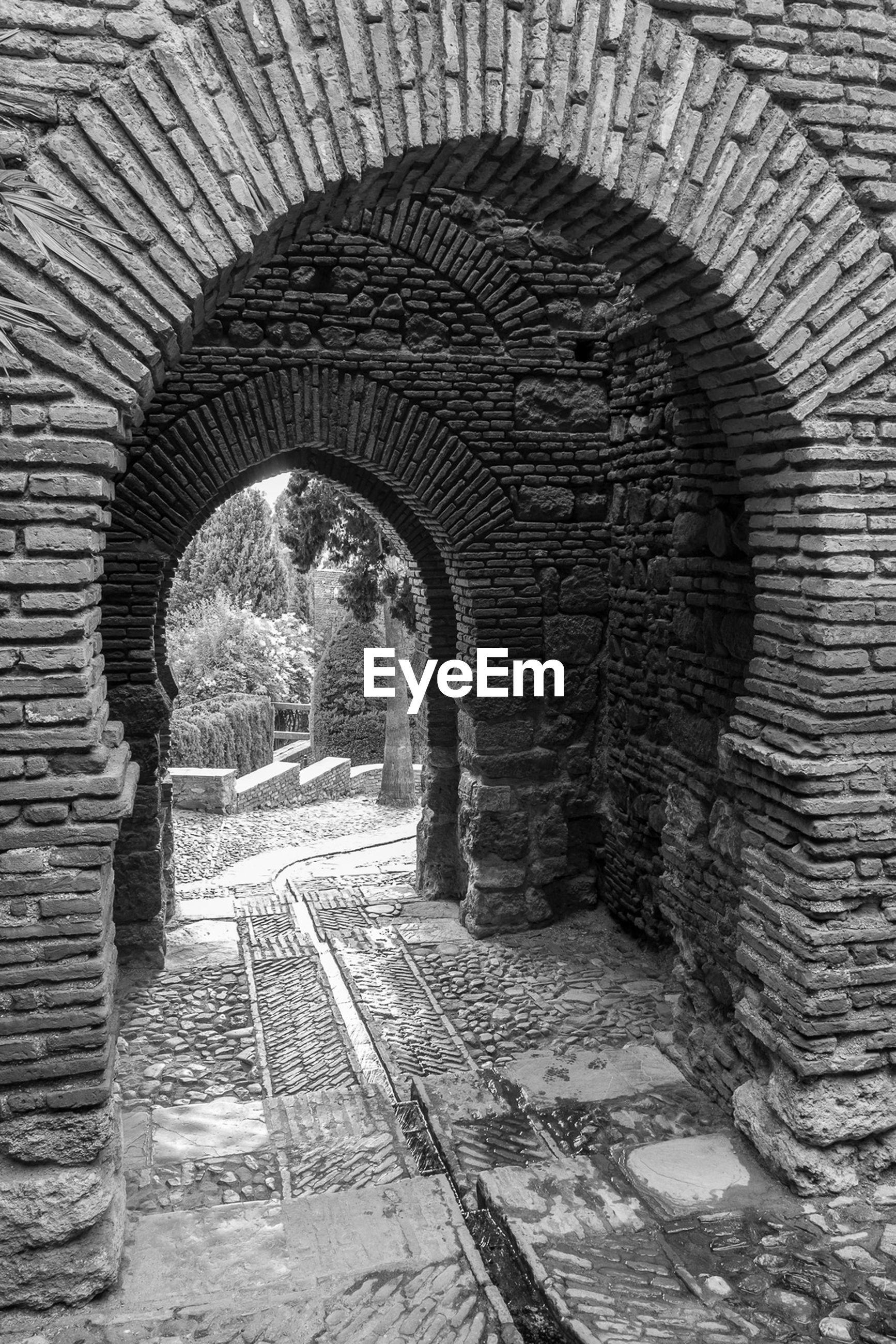 Archway at alcazaba of malaga fort