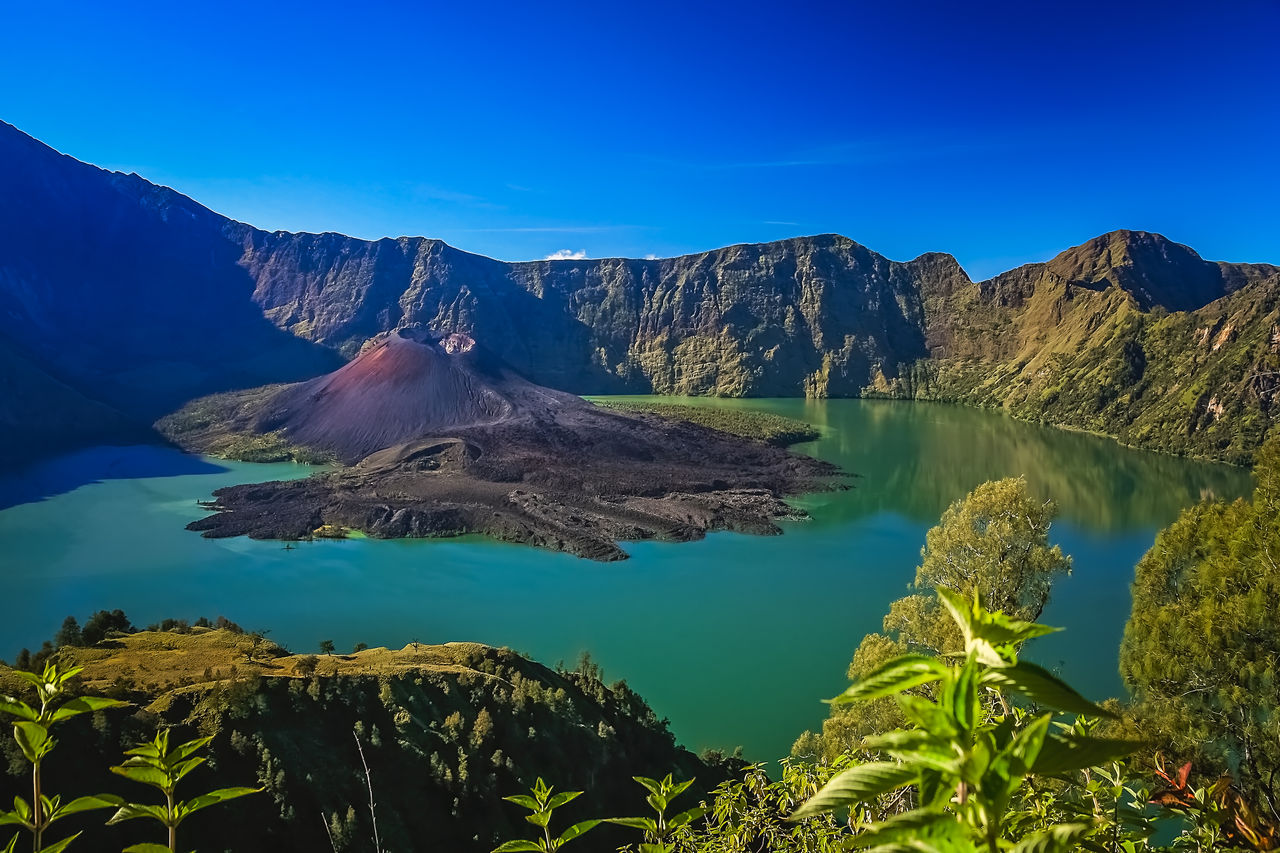 mountain, scenics - nature, beauty in nature, tranquil scene, water, tranquility, sky, nature, volcano, non-urban scene, mountain range, idyllic, blue, day, no people, travel destinations, sea, geology, solid, volcanic crater, outdoors, mountain peak, formation