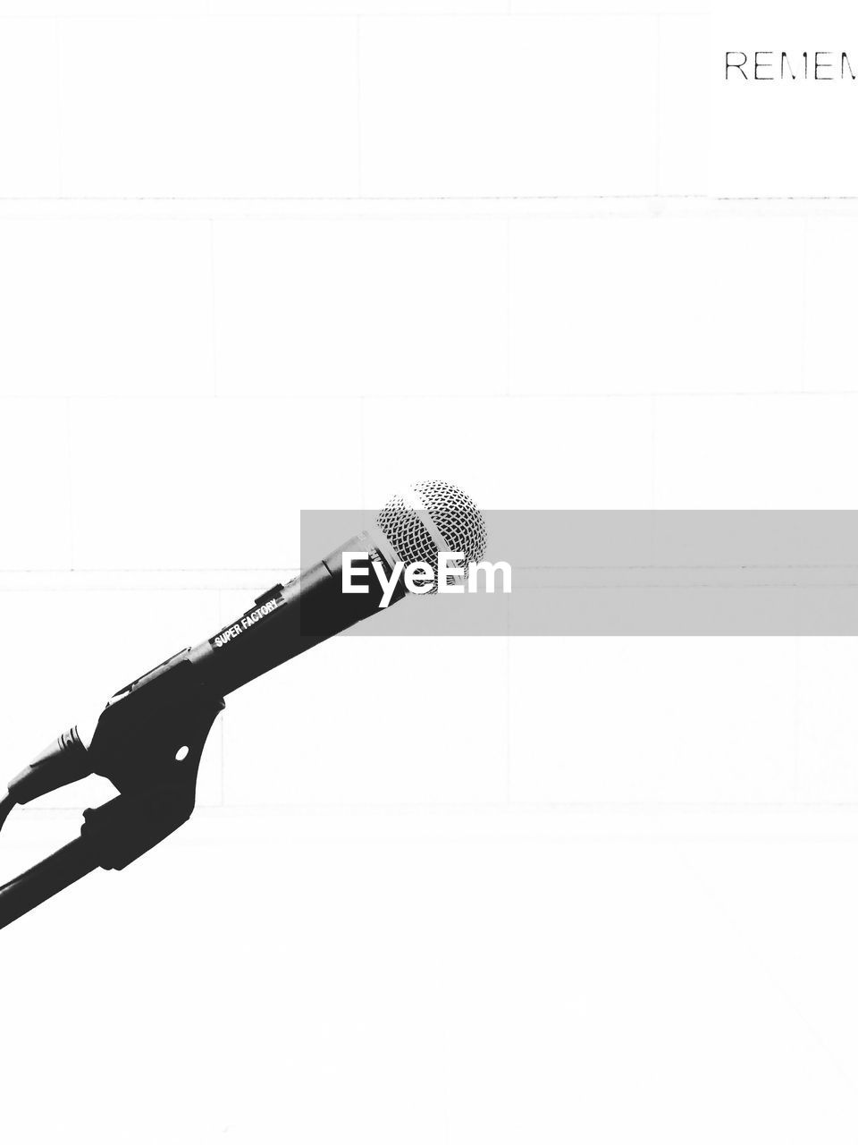 microphone, single object, microphone stand, no people, indoors, shower head, close-up, white background, arts culture and entertainment, studio shot, technology, day