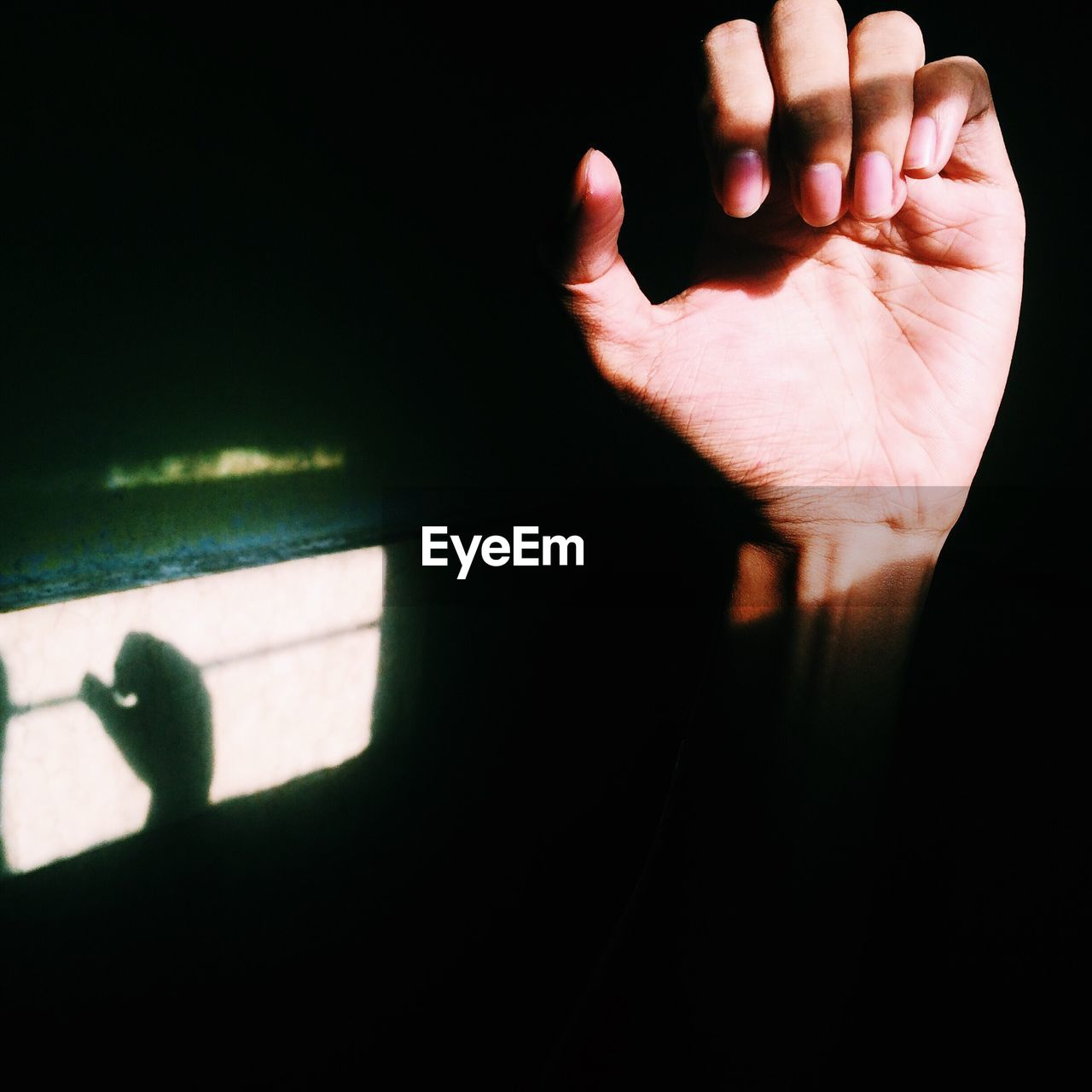 Close-Up Of Hand Against The Dark