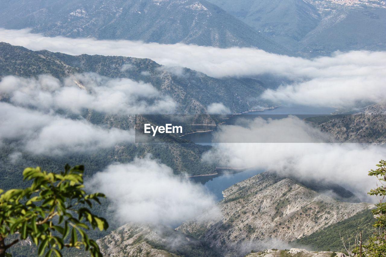 HIGH ANGLE VIEW OF FOG OVER MOUNTAIN