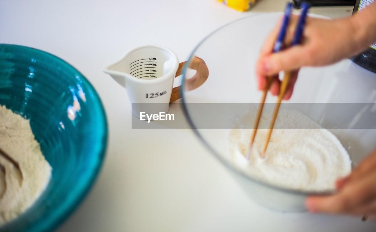 Close-up of hands preparing food