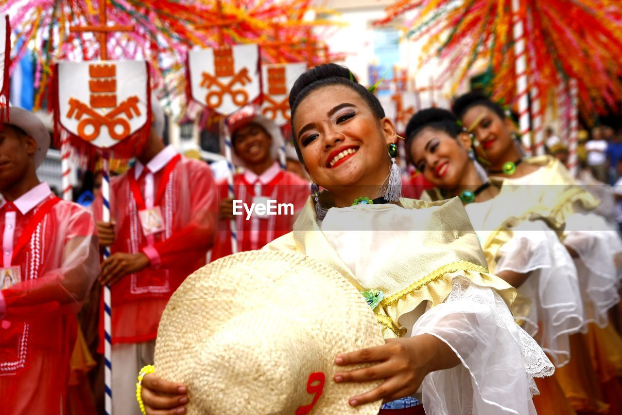 traditional clothing, smiling, women, adult, emotion, happiness, lifestyles, real people, men, portrait, focus on foreground, group of people, incidental people, front view, celebration, people, clothing, couple - relationship