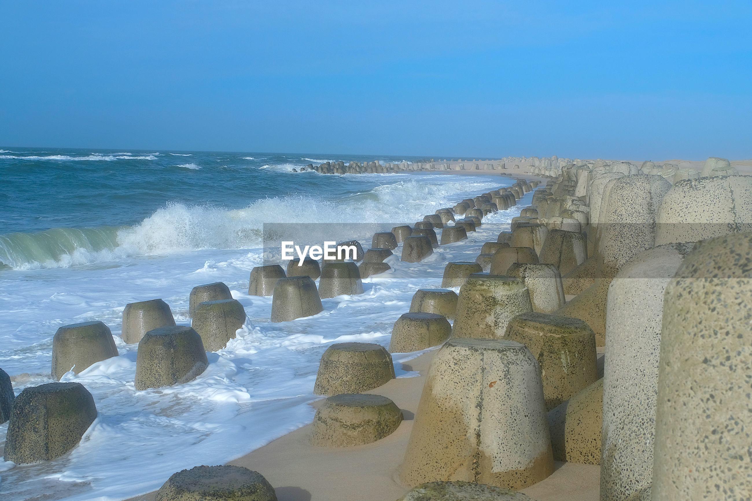 Four-legg concrete tetrapod structure in hoernum beach. reduce coastal erosion and land loss.
