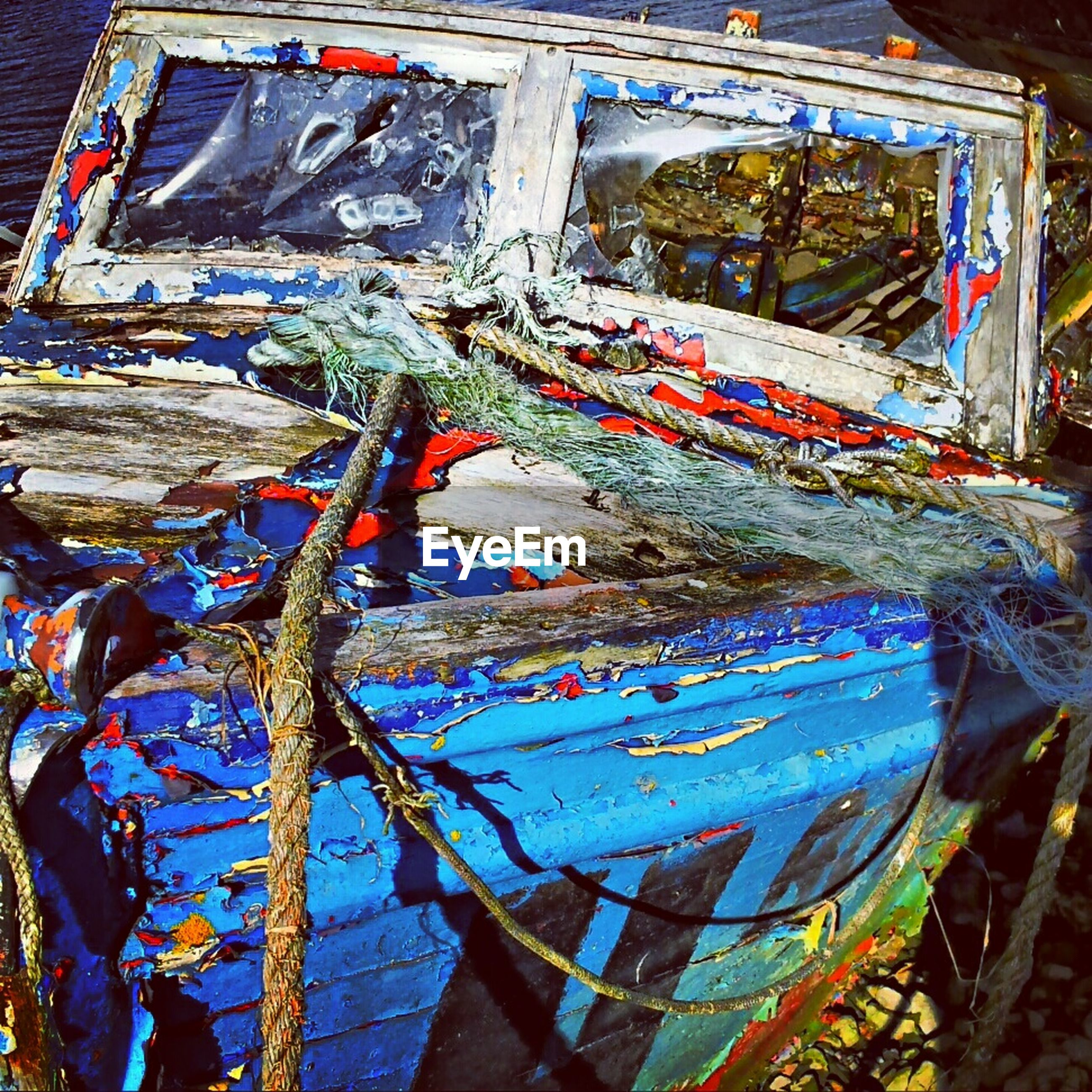 abandoned, obsolete, damaged, old, run-down, mode of transport, nautical vessel, transportation, deterioration, built structure, boat, architecture, blue, moored, weathered, building exterior, bad condition, destruction, outdoors, day