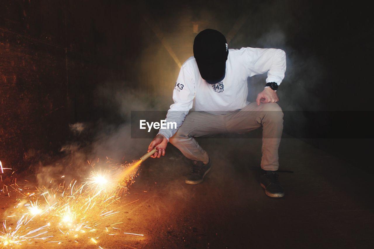 Man Holding Firecracker