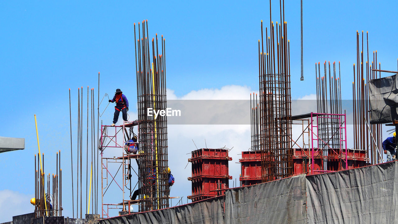 sky, industry, architecture, built structure, construction site, construction industry, working, occupation, men, development, day, real people, nature, one person, building exterior, machinery, construction worker, incomplete, outdoors