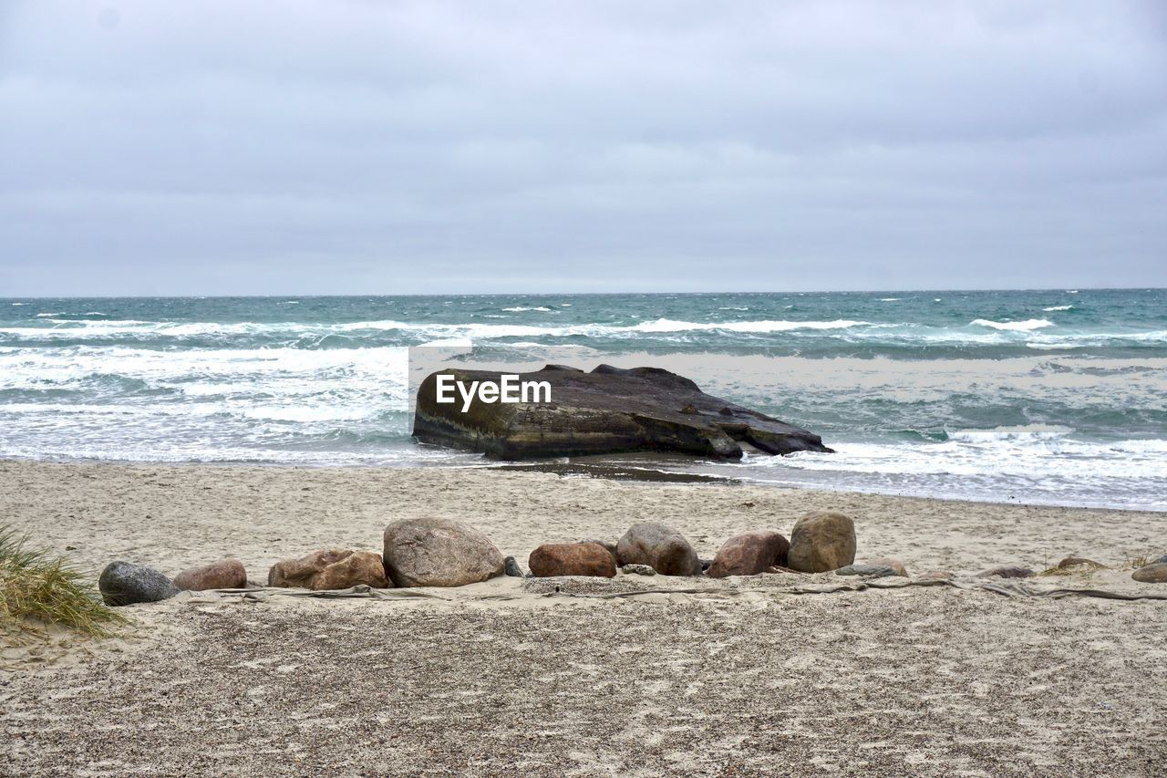 sea, sky, water, land, horizon over water, horizon, beach, beauty in nature, scenics - nature, rock, nature, cloud - sky, solid, rock - object, no people, wave, day, tranquil scene, tranquility, outdoors