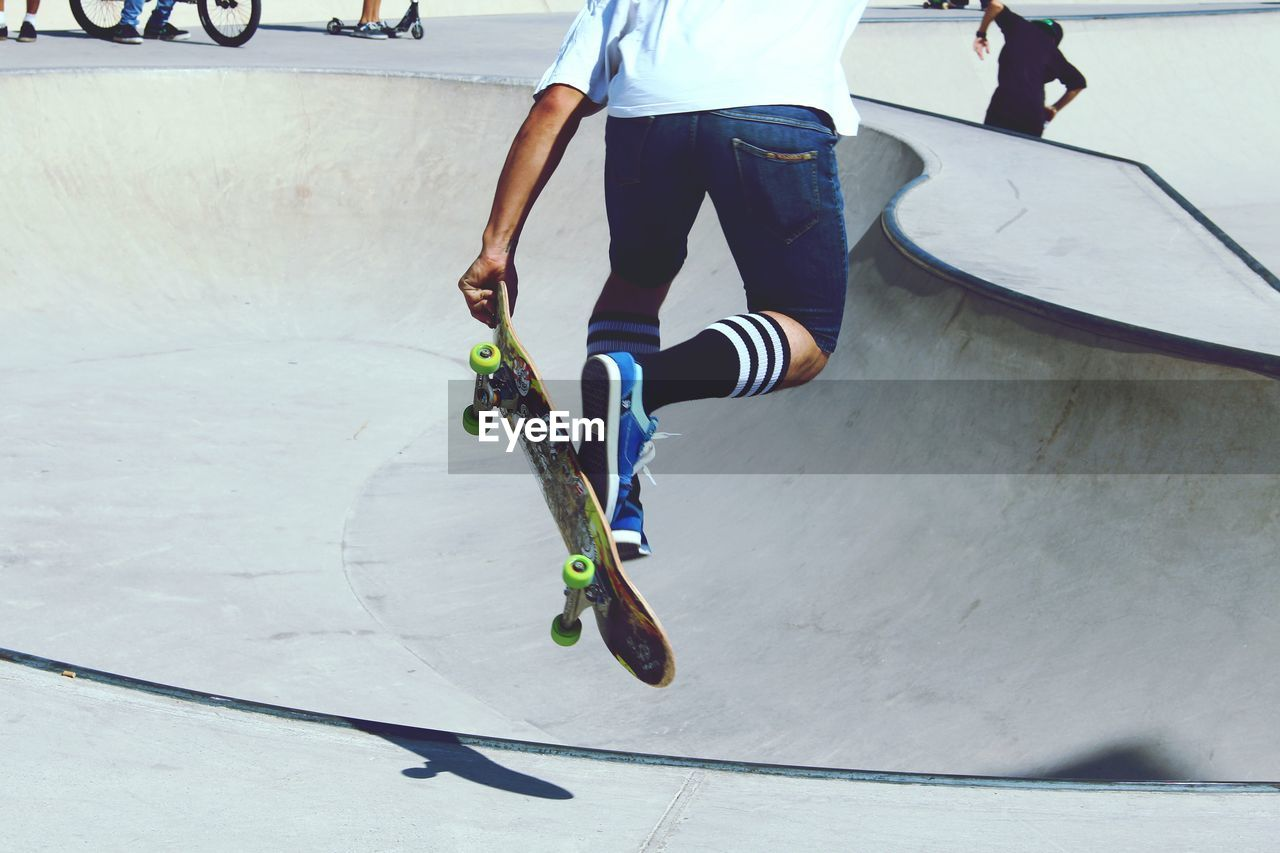 sport, skill, skateboard, skateboard park, real people, low section, leisure activity, sports ramp, lifestyles, shadow, balance, day, men, outdoors, sunlight, motion, stunt, one person, exercising, standing, youth culture, extreme sports, sportsman, adult, people