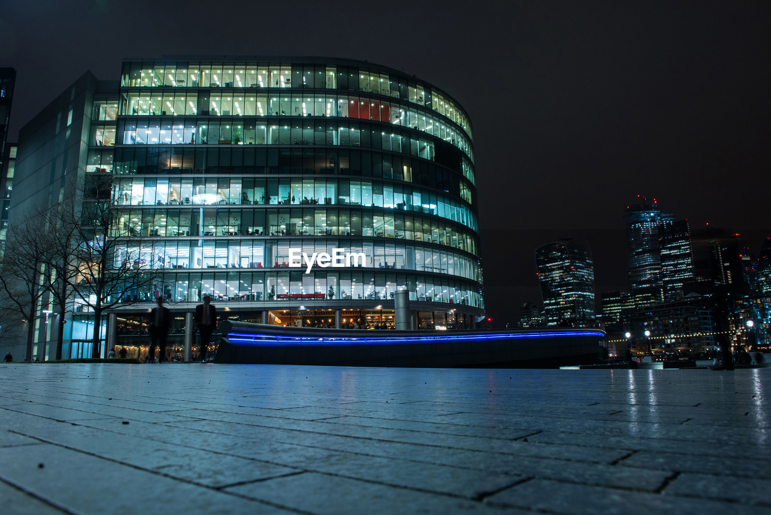 Illuminated modern buildings in city at night