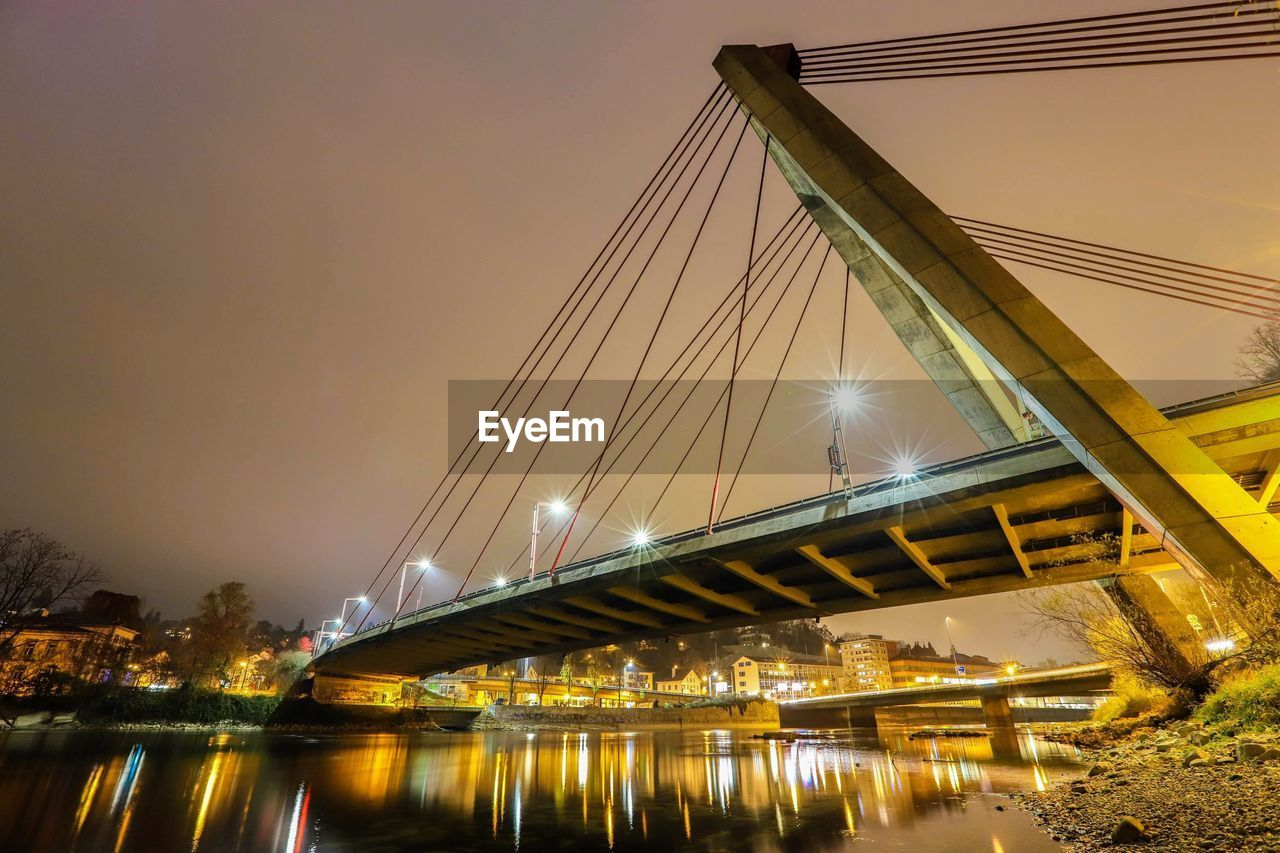 bridge, connection, bridge - man made structure, illuminated, architecture, water, built structure, sky, transportation, night, engineering, reflection, nature, river, building exterior, city, street light, low angle view, outdoors, light