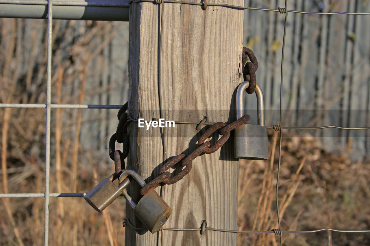 metal, safety, security, protection, fence, barrier, boundary, no people, barbed wire, day, focus on foreground, close-up, wire, chain, rusty, outdoors, gate, hanging, nature, lock