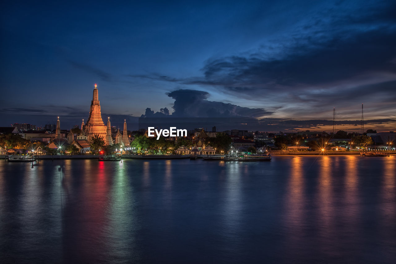 built structure, architecture, building exterior, sky, illuminated, waterfront, building, water, cloud - sky, night, travel destinations, city, religion, place of worship, belief, nature, no people, reflection, dusk, outdoors, cityscape, spire