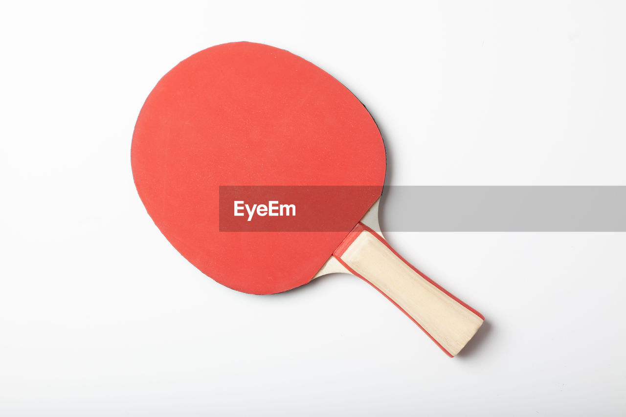 Close-Up Of Table Tennis Bat On White Background