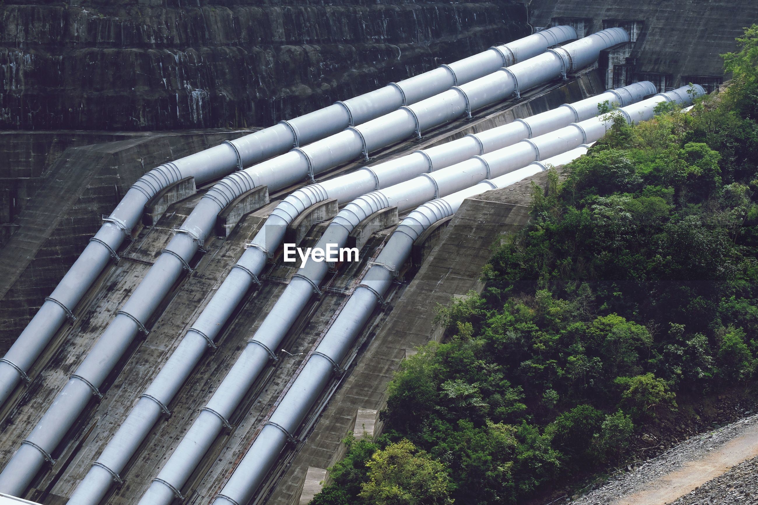 High angle view of pipelines at factory