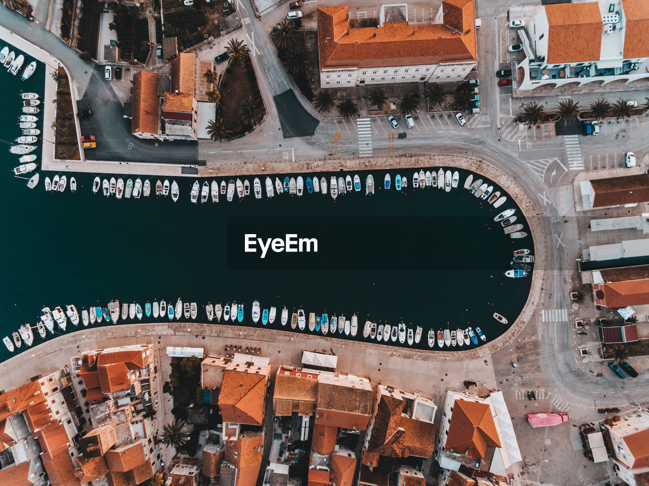 Aerial view of harbor by buildings in city