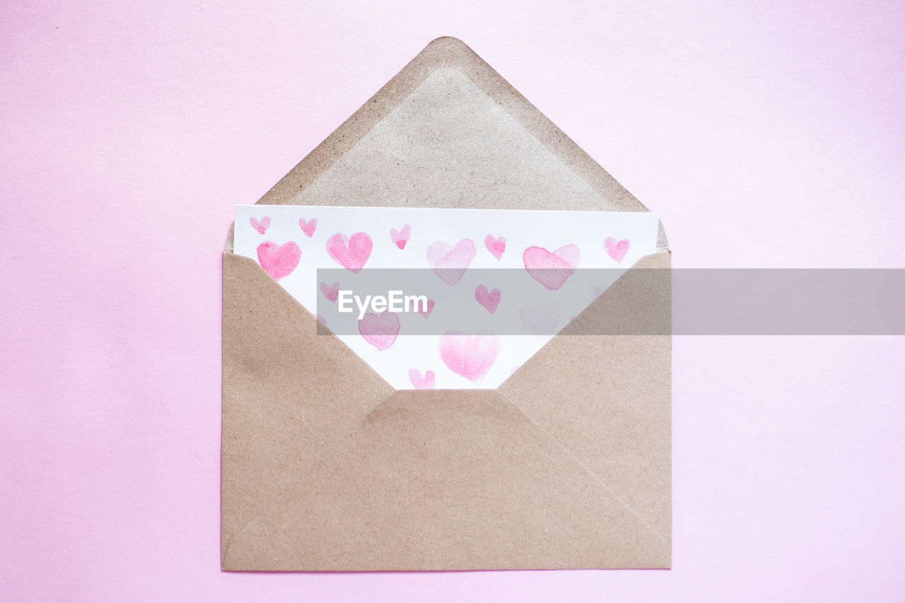 CLOSE-UP OF HEART SHAPE MADE OF PINK PAPER