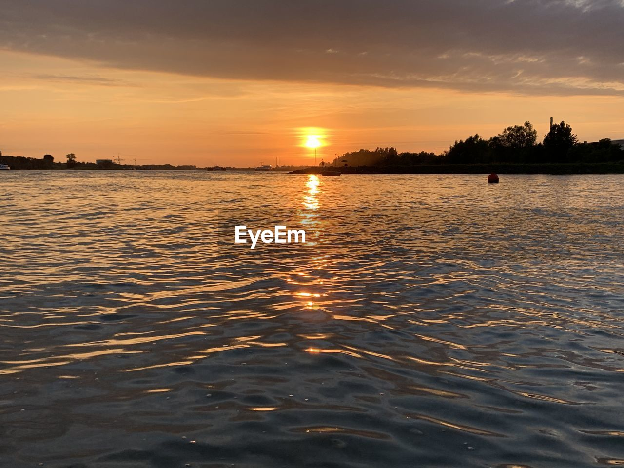 sunset, sky, water, beauty in nature, scenics - nature, waterfront, orange color, tranquility, tranquil scene, cloud - sky, nature, reflection, idyllic, sea, silhouette, rippled, no people, non-urban scene, outdoors