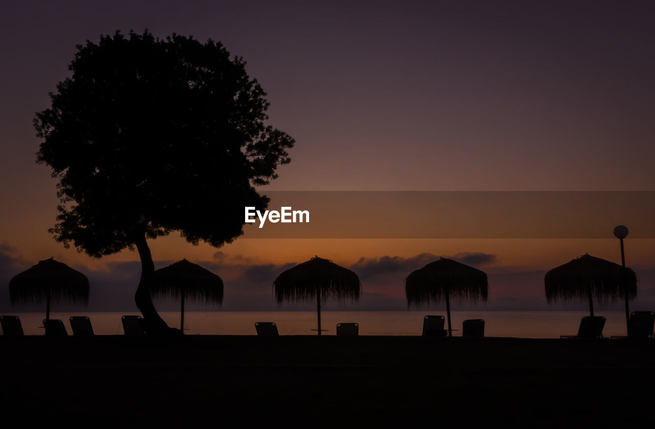 sky, sunset, silhouette, beauty in nature, scenics - nature, tree, plant, water, tranquil scene, tranquility, nature, land, orange color, sea, beach, idyllic, outdoors, no people, copy space