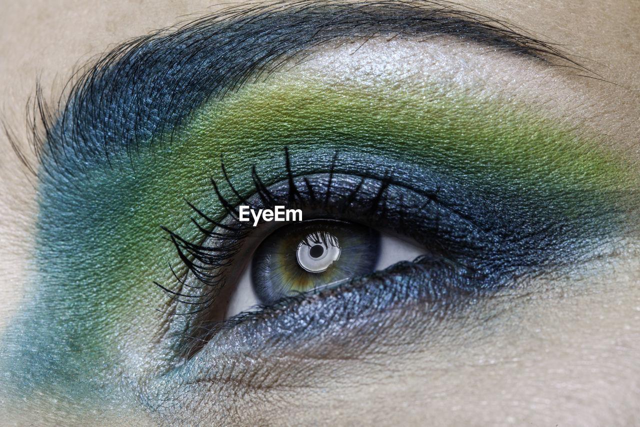 Close-up of woman wearing eye make-up