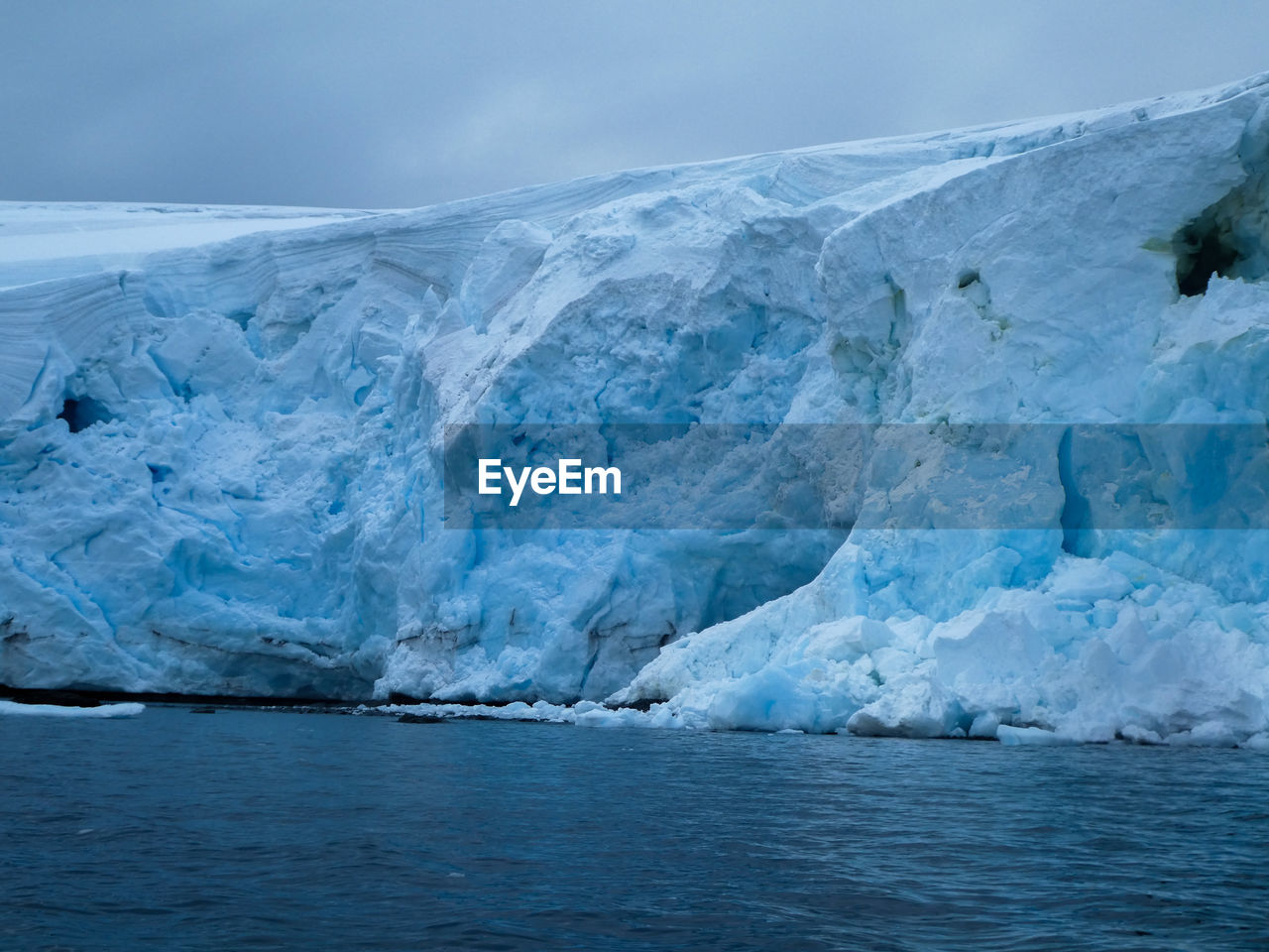 water, ice, glacier, cold temperature, environment, sea, landscape, waterfront, sky, scenics - nature, beauty in nature, frozen, tranquil scene, iceberg, winter, nature, tranquility, no people, day, melting, floating on water