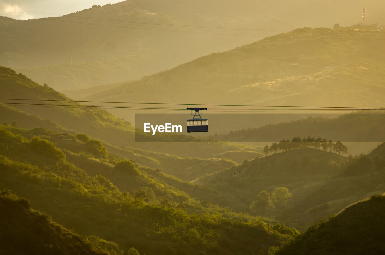 Mid Distance Of Overhead Cable Car Over Foggy Landscape