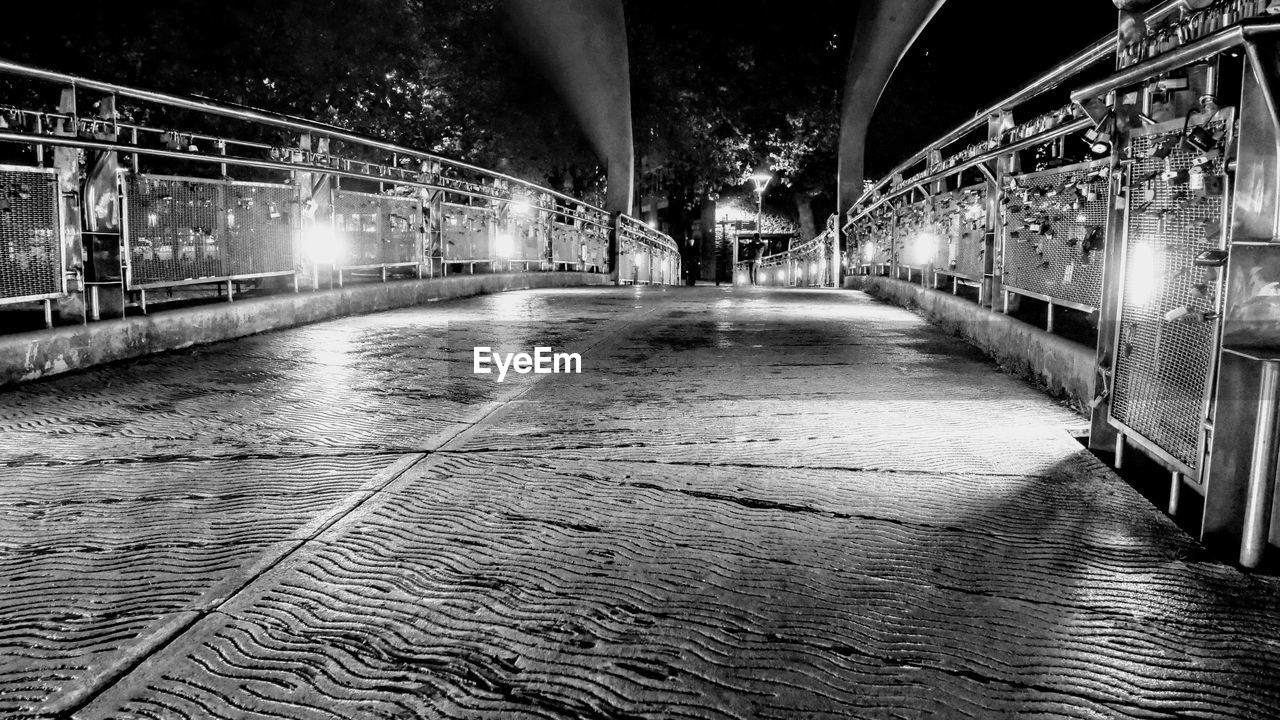 architecture, built structure, illuminated, the way forward, direction, connection, bridge, night, transportation, bridge - man made structure, no people, diminishing perspective, arch, railing, water, city, motion, nature, outdoors, lighting equipment, long