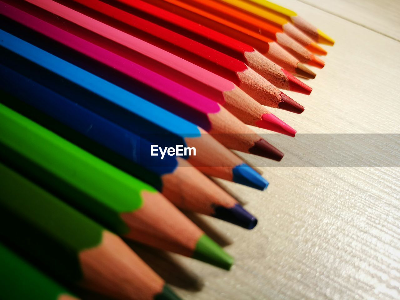 Close-Up Of Colorful Pencils Arranged On Table