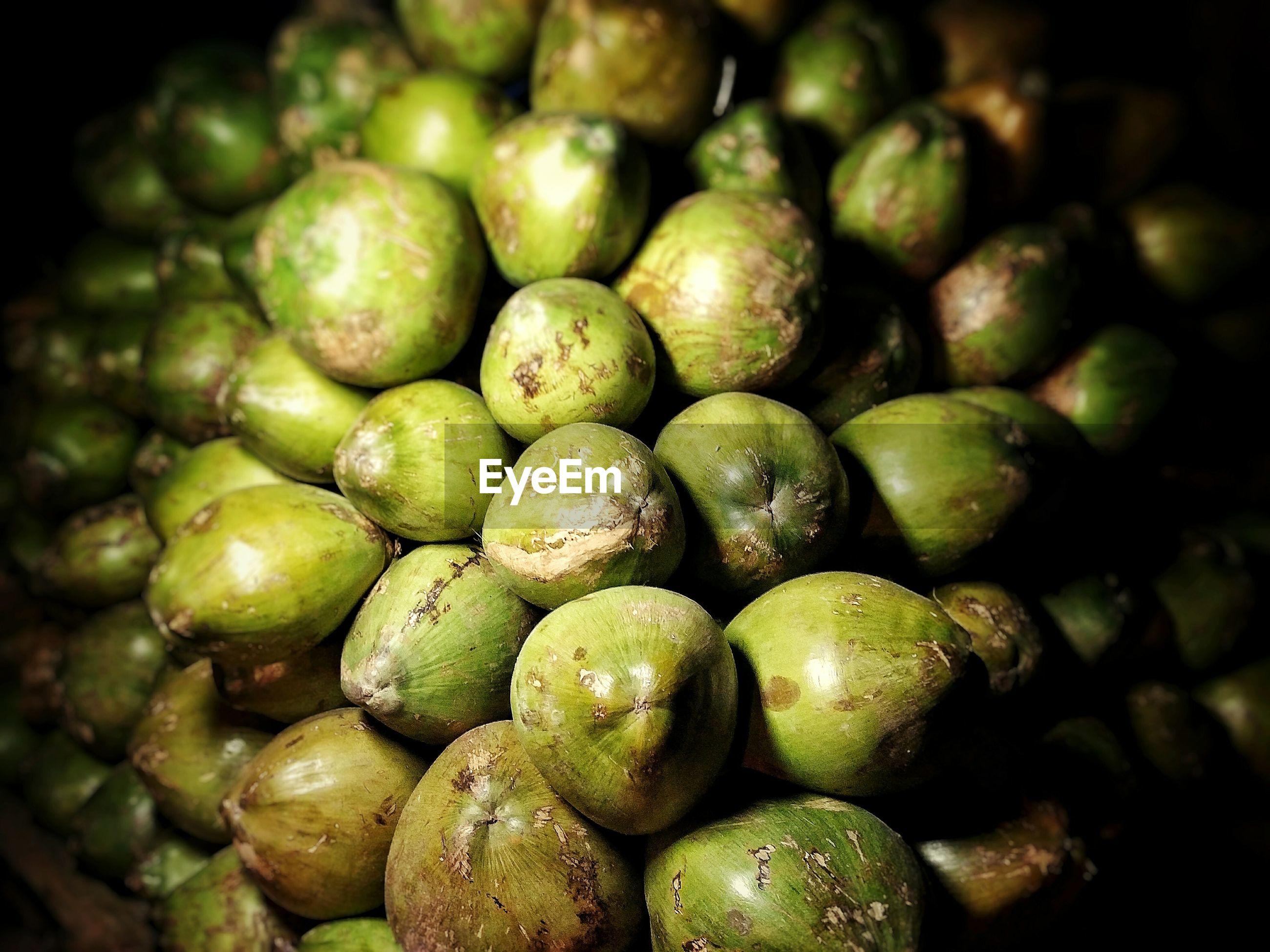 FULL FRAME SHOT OF GREEN FRUIT