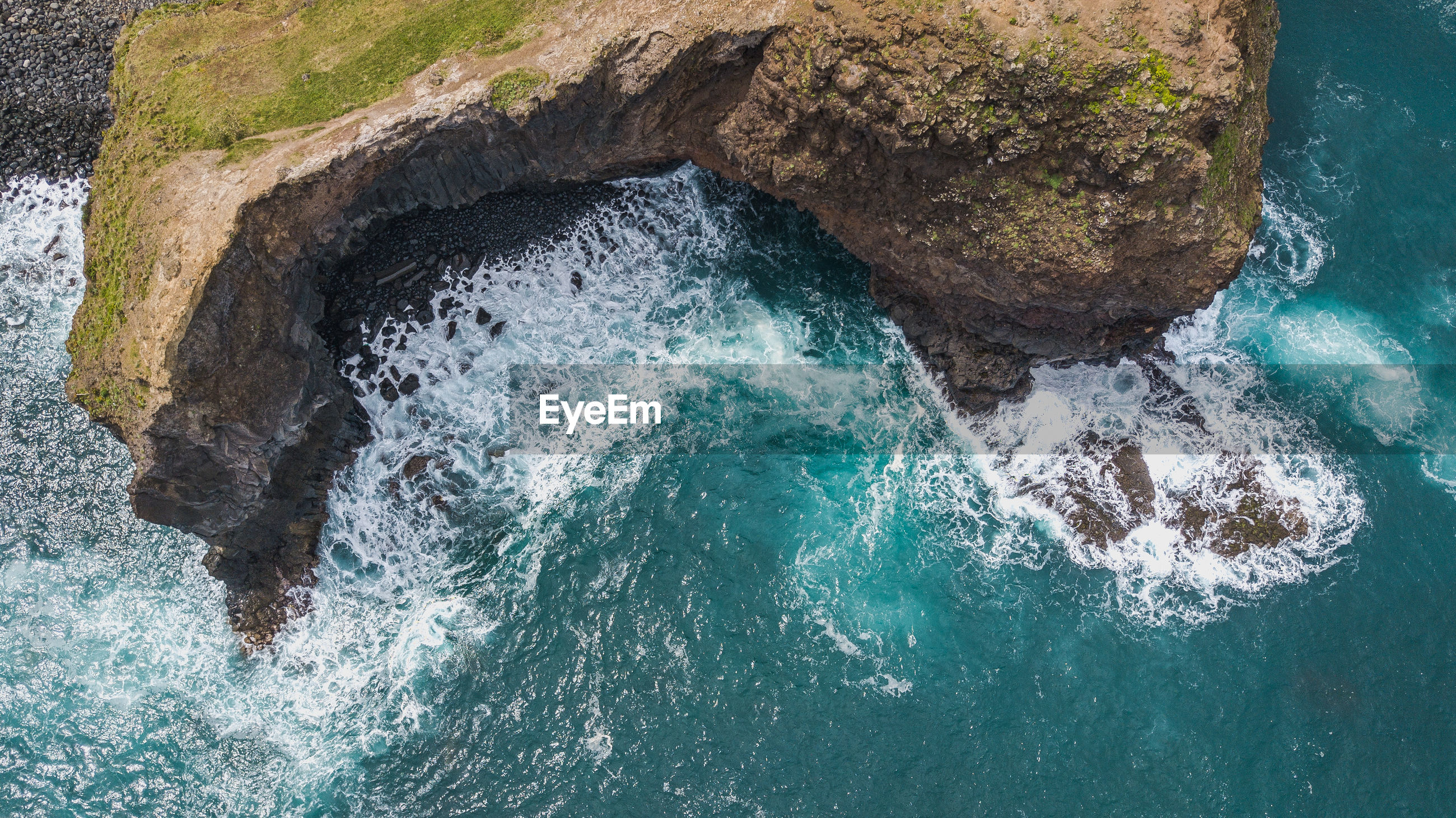 Aerial view of rock formation in sea