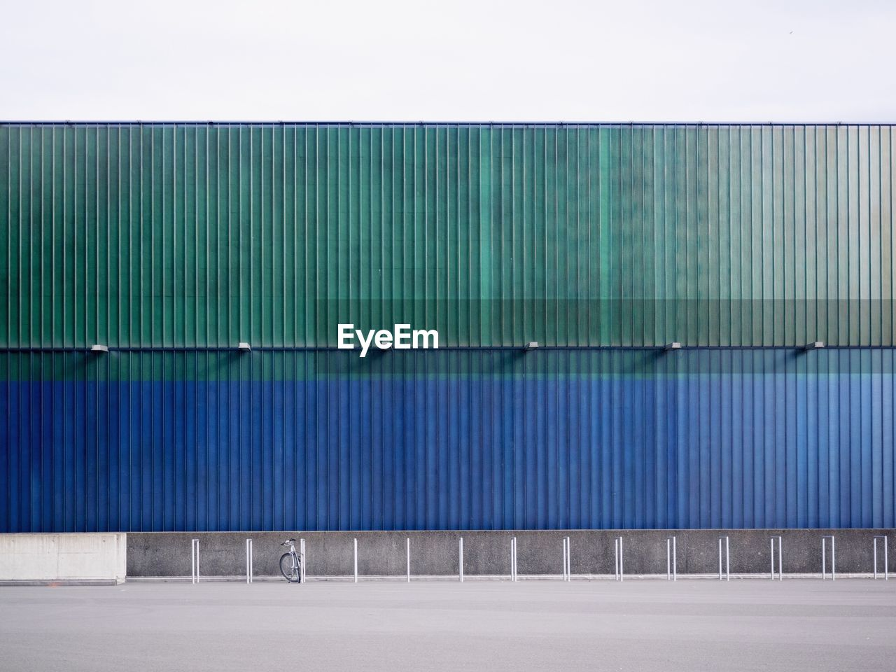 wall - building feature, corrugated iron, architecture, built structure, no people, metal, iron, day, blue, corrugated, building exterior, outdoors, green color, nature, pattern, industry, container, security, transportation, sunlight, sheet metal