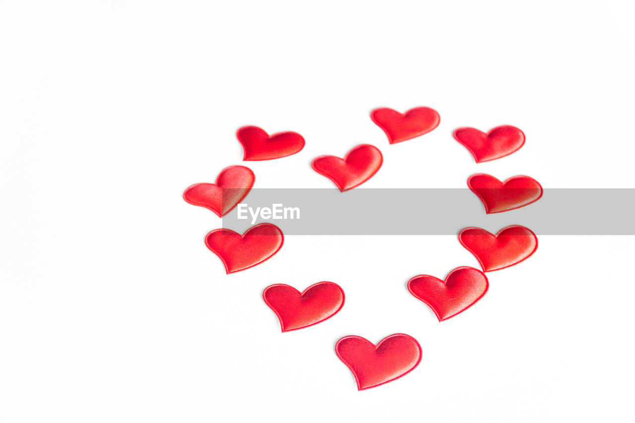 white background, studio shot, red, heart shape, indoors, close-up, love, copy space, positive emotion, cut out, still life, no people, emotion, creativity, shape, white color, directly above, art and craft, high angle view, design, valentine's day - holiday