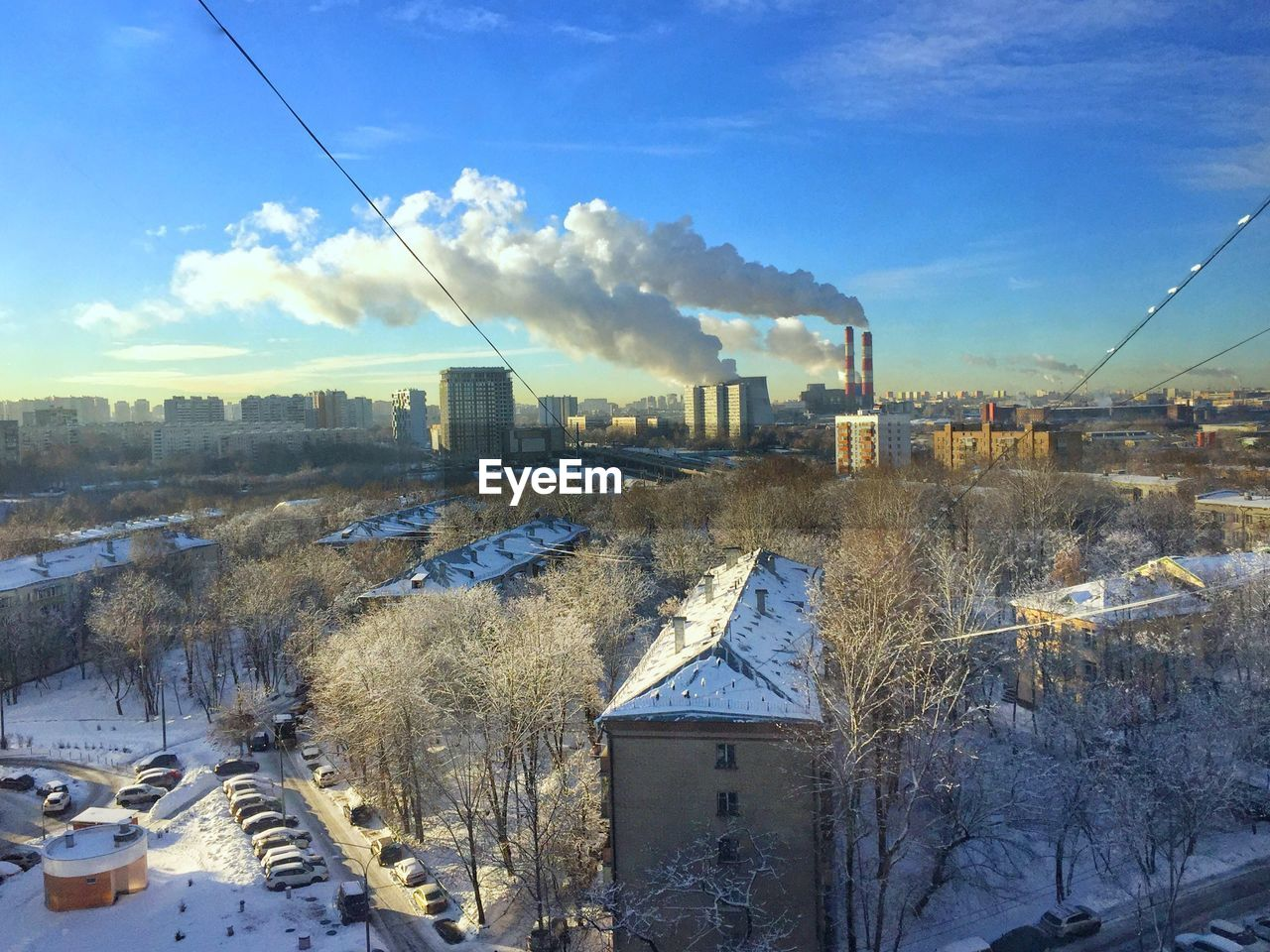 built structure, building exterior, architecture, sky, cloud - sky, winter, smoke - physical structure, nature, cold temperature, industry, snow, smoke stack, factory, no people, building, tree, pollution, day, city, outdoors, air pollution, cityscape
