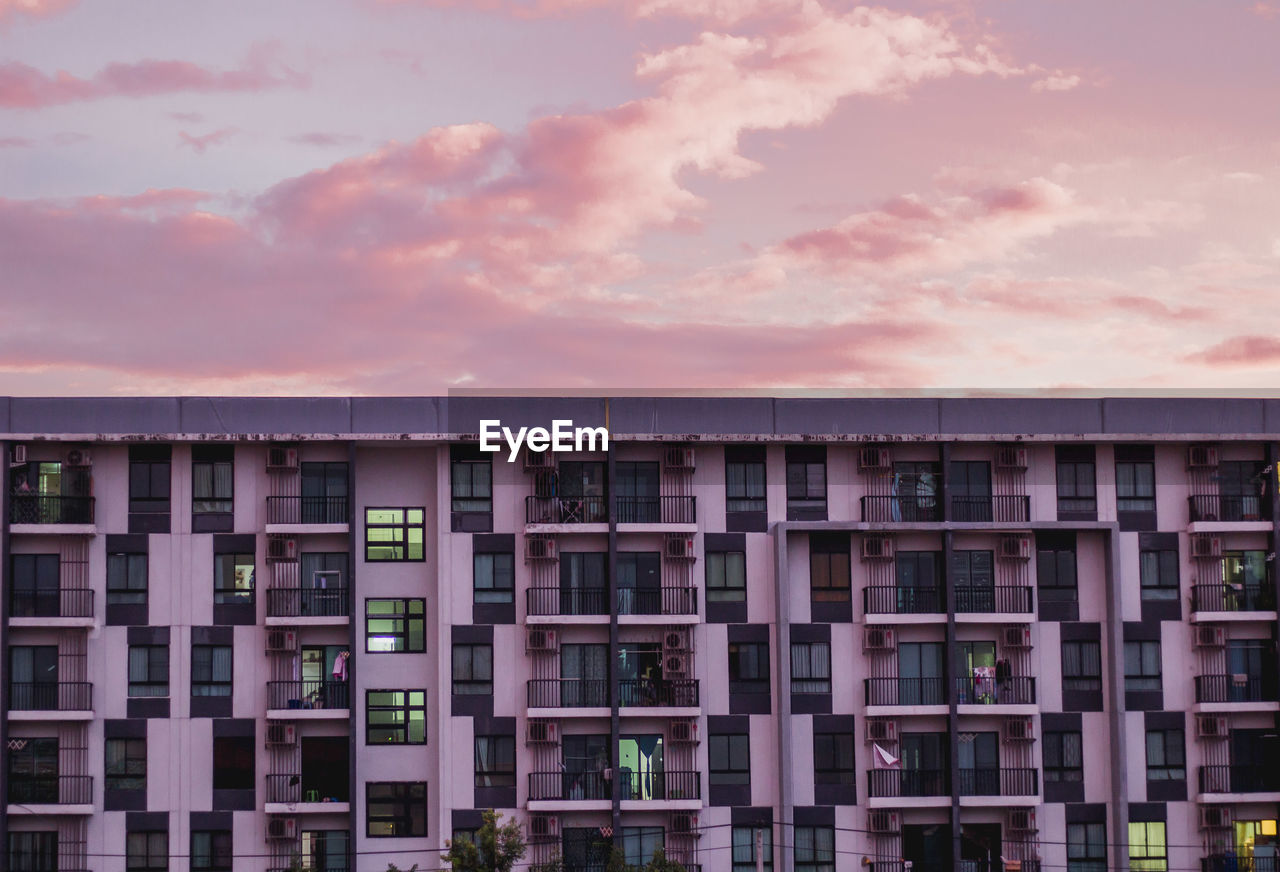 RESIDENTIAL BUILDING AGAINST SKY DURING SUNSET