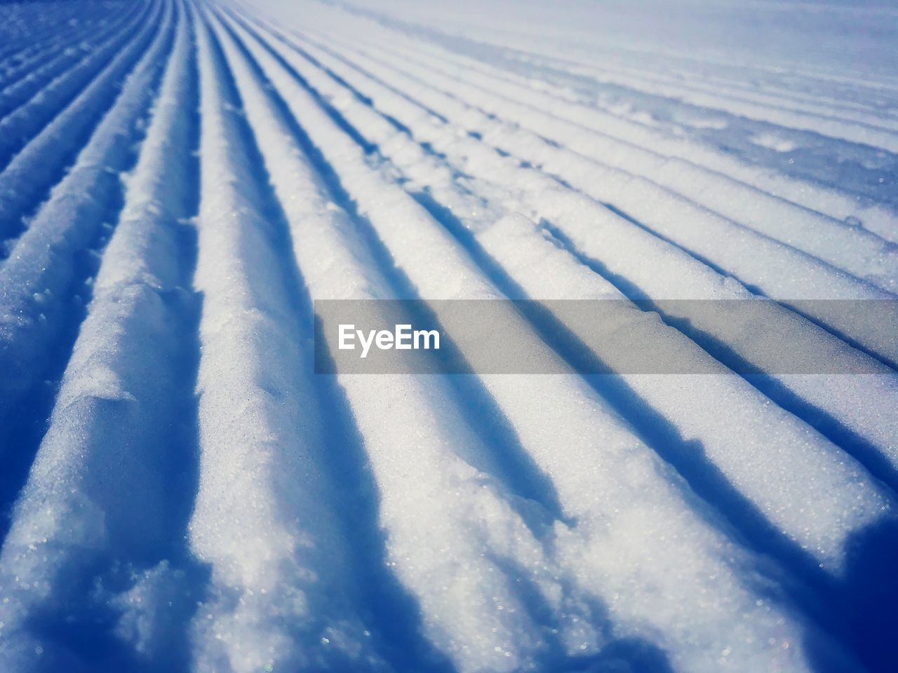 winter, snow, cold temperature, no people, nature, white color, covering, day, beauty in nature, land, pattern, ski track, field, frozen, scenics - nature, outdoors, tranquility, environment, high angle view, powder snow