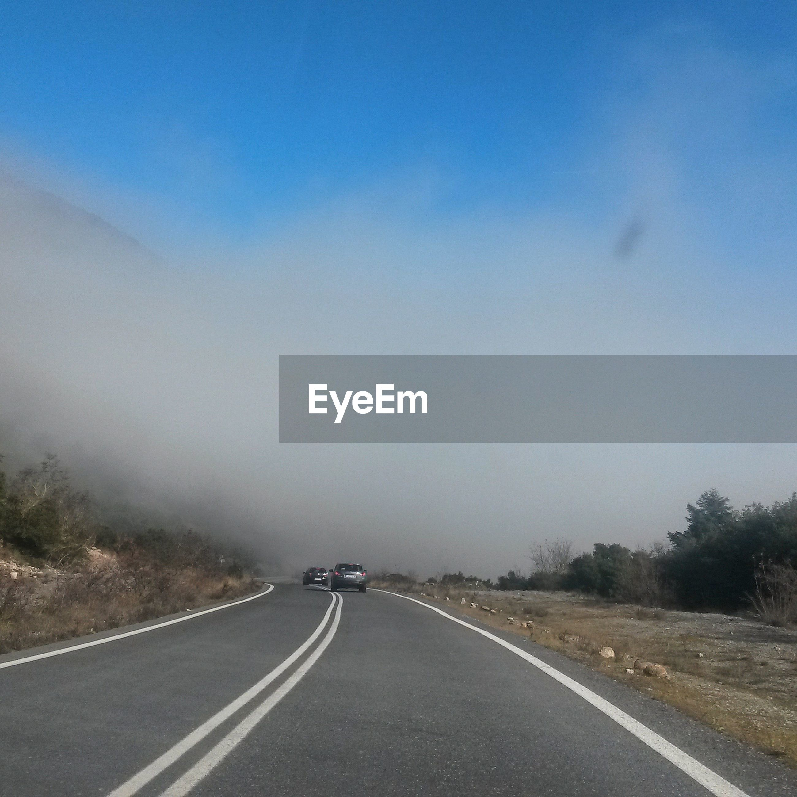 Road against cloudy sky