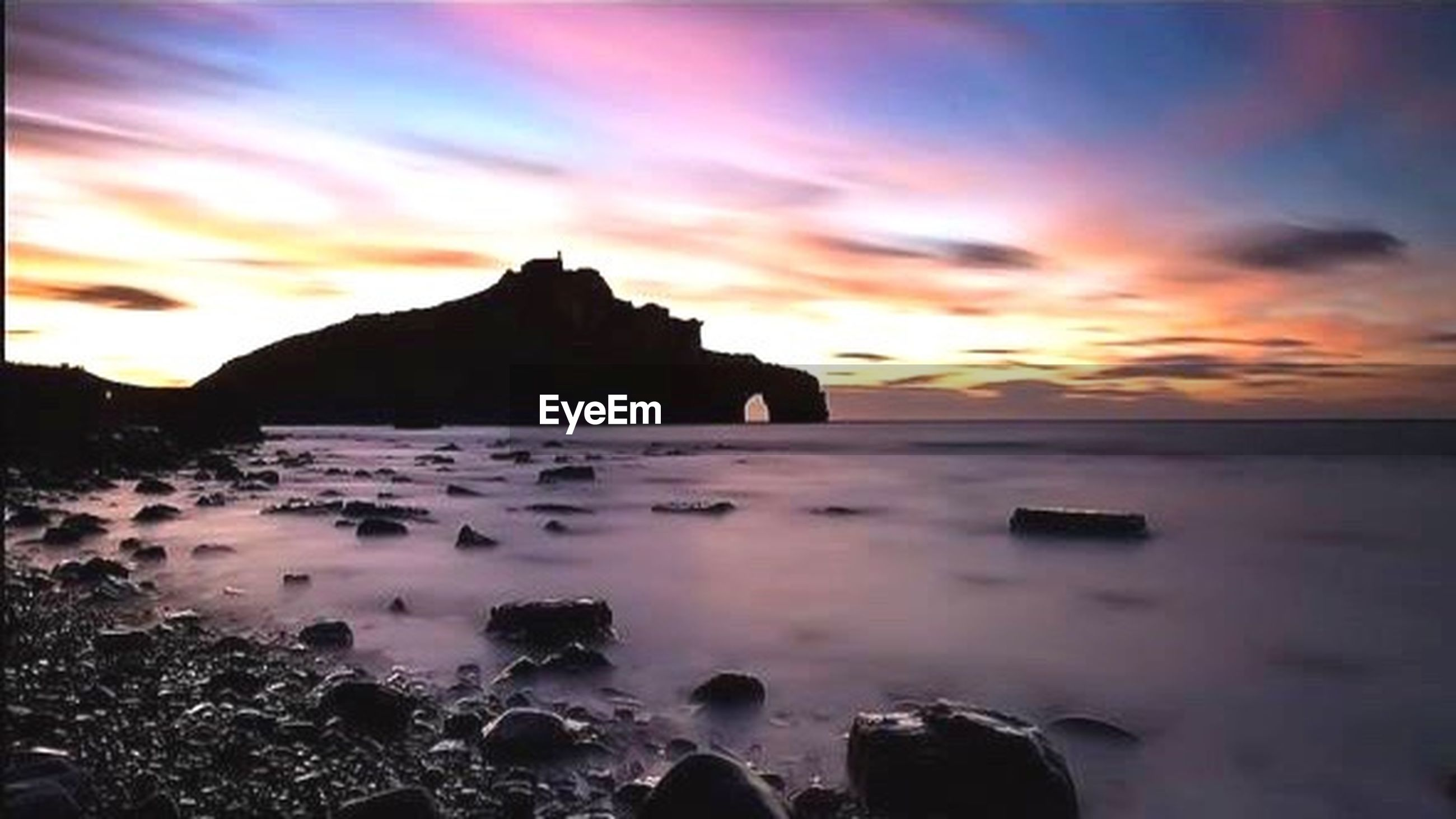 sunset, water, scenics, sea, sky, beauty in nature, tranquil scene, tranquility, orange color, cloud - sky, rock - object, nature, idyllic, beach, horizon over water, shore, rock formation, dramatic sky, dusk, cloud