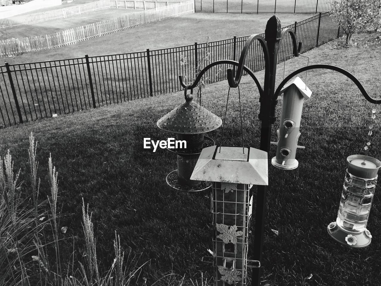 metal, day, no people, barrier, nature, boundary, fence, grass, plant, lighting equipment, field, safety, land, protection, outdoors, security, front or back yard, railing, absence, hanging, electric lamp