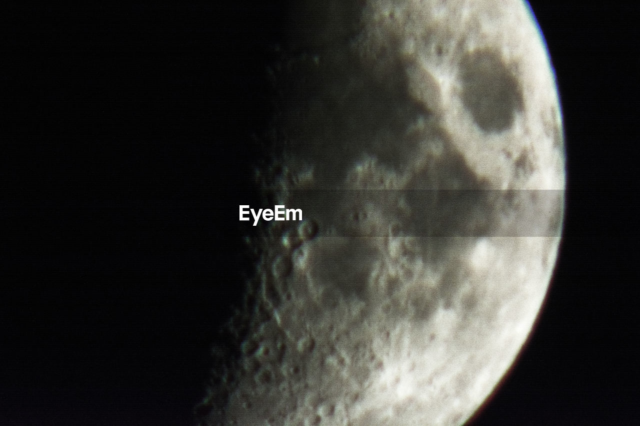CLOSE-UP OF MOON AGAINST SKY